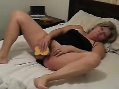 Mature Couple Having Fun In Bed With A Dildo