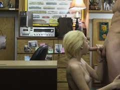 Short Haired Blonde Beauty Bent Over Desk In Office