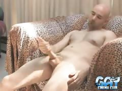 Trashy bald gay Bucky wanking his enormous penis on the