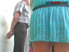 Mini skirt upskirt of brunette babe