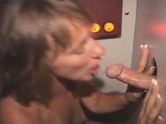 Dirty Brunette Slut Slurps Dick Through A Glory Hole